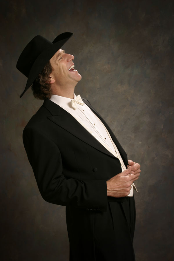 Image of Brantford Symphony Orchestra Musical Director Philip Sarabura wearing a cowboy hat and laughing