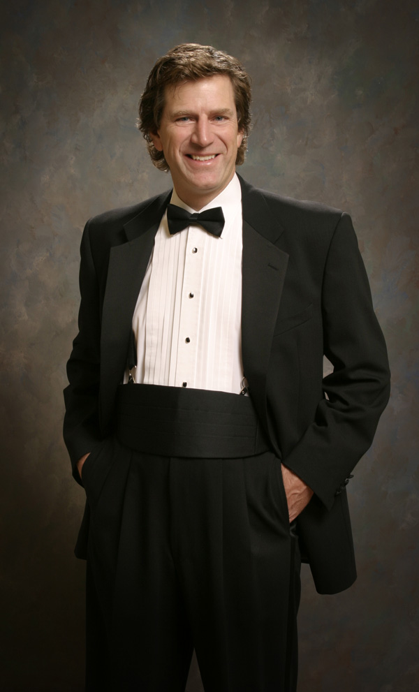 Image of Music Director Philip Sarabura in a tuxedo